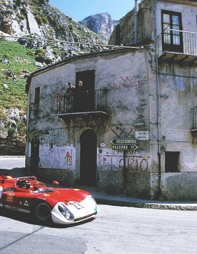 Gallery image for driving experience in Sicily - red porsche on road bend